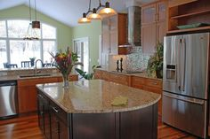"Backsplash with giallo granite and dark cabinets  ""light & dark Cherry Decora cabinets, Giallo Ornamental granite & Zebra hardwood flooring make this kitchen design truly layered in style. A..."