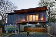 contemporary container home on stilts