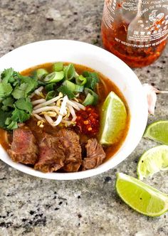 This take on the traditional Vietnamese homemade pho soup combines citrus flavours, beef broth and red curry paste for a spicy, filling soup!