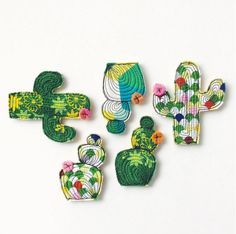 This cactus is sewn free hand using free motion sewing. It is made from a beautiful hexagon fabric and black thread. The ouch flower is Cactus Decor, Cactus Art, Free Motion Embroidery, Free Machine Embroidery, Textile Jewelry, Fabric Jewelry, Jewellery, Brooches Handmade, Hand Applique