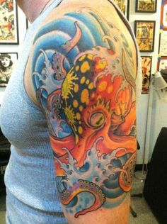 Classic tattoo design elements add to the decorative nature of this octopus tattoo