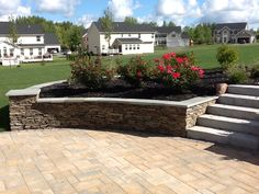 Add a splash of color in a raised planting bed! Created by Bristol's Garden Center (Victor, NY).