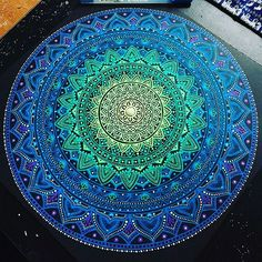 Mandala with Gelly Roll pens on black paper