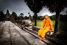 Monk sits under coconut tree in Angkor Wat Temple by Oat Vaiyaboon on 500px