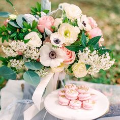 The most romantic styled proposal in a blooming spring meadow, with a lush, gorgeous blush bouquet and calligraphed macarons to celebrate!