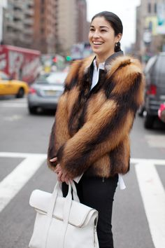 Caroline Issa in red fox fur coat.