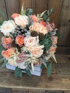 Peach wedding bouquet with garden scented roses, miss piggy roses and succulents