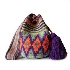 $49.90-$52.90 #Wayuubags. These double thread small mochila bag are perfect for carrying around a few items such as your phone, wallet and a few other necessities. All Wayuu bags come with a handwritten postcard, and little gift. The time required to elaborate a Wayuu Mochila varies from 4-7 days. www.lombiaandco.com Gifts For Young Women, Mochila Crochet, Tapestry Crochet Patterns, Tapestry Bag, Knitting Wool, Phone Wallet, Crochet Accessories, Little Gifts, Cute Gifts
