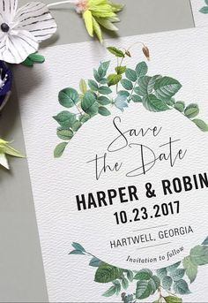 Delicate leaves and buds frame this design, paired with both clean modern type and a fun hand-drawn calligraphy font. Think of a vase filled with sprigs and vines, spilling over the sides, lit by a beam of sunlight. #weddinginvitation