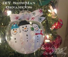Easy DIY Snowman Christmas Ornaments made using your children's fingerprints!  A can't miss holiday craft!
