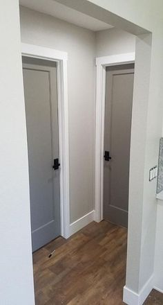 Grey interior doors with oil rubbed bronze hardware. Wall color is Behr mineral. Grey interior doors with oil rubbed bronze hardware. Wall color is Behr mineral. Grey Interior Doors, Interior Door Colors, Grey Doors, Black Doors, Painting Interior Doors, Farmhouse Interior Doors, Interior Door Styles, Interior Trim, Trim On Doors