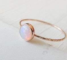 Opal Ring, Rainbow Opal Ring, Glowing Opal Jewelry, Stack Ring, Stackable Opal Ring, October Birthstone, White Opal Ring, Stackable Ring  This beautiful 6mm Opal is a gorgeous piece for your fiancé, mom, sister, best friend or yourself! It is held by solid 14k Gold and simply glows its way into your heart!  The ring can be made in 14k Rose Gold or 14k Yellow Gold.  ➼ 6mm natural Opal ➼ set in recycled 14k Gold ➼ ring band measures 1mm ➼ your ring arrives gift wrapped in a box…