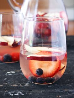 Red, White & Blue Sangria - 2 bottles white wine - 6 oz blueberries - 6 oz raspberries - 8 oz strawberries thinly sliced - 1 red apple, thinly sliced - 4 tbsp Grand Marnier - 2 tbsp sugar