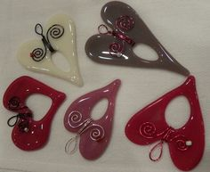 PHOTO BY KATE HOOTS - These fused glass hearts, made by Oregon City artist Kristi Costanzo, make a sweet gift for Valentine's Day. Find them at the Backyard Bird Shop for just $9.99.