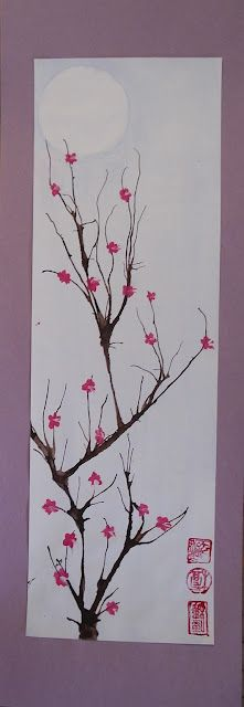 Sakura. Kids made their own today, by blowing through a straw onto ink blots for the trunks, and using fingers in pink paint for the blossoms.