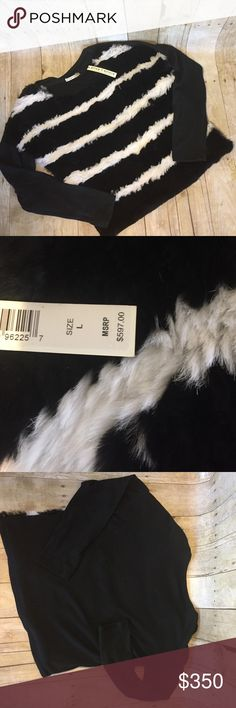 ALICE + OLIVIA black and white real rabbit fur L ALICE + OLIVIA real rabbit fur NWT size Large black and white sweater. This is a 597.00 sweater. Bust 22 inches length 22. This is great for the holiday season. Alice + Olivia Sweaters Crew & Scoop Necks