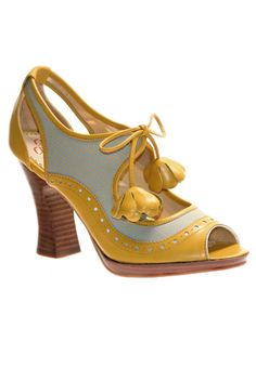 Poetic License 'Girl About Town' shoe. I don't like the heel - in fact it's possible the whole shoe is hideous. But there's something about the eccentric color combination and brogue detailing that just grabs me.