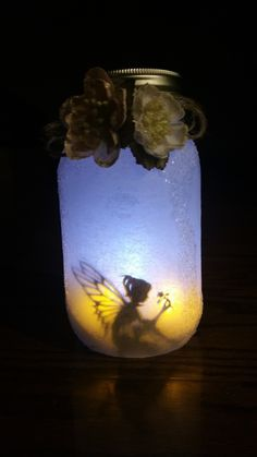 I used 2 warm LED tea lights in the front and 1 cool LED tea light in the back, to create that look. Fairy Silhouette was created by Laser Cuts. This pic was taken in low light to show the color effect.