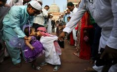 An Indian Muslim boy leans to rub noses with a girl as they are both dressed up for Eid al-Fitr (the end of Ramadan) prayers at the Jama Masjid in New Delhi, India, Aug. Photography by: Kevin Frayer Precious Children, Beautiful Children, Beautiful People, Beautiful Images, Festivals Of India, Happy Photos, Nice Photos, We Are The World, Press Photo