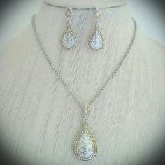 "SALE!!Final!Necklace & Earring Set Two-tone white topaz necklace and earring set. Very eye catching! Chain 16"" and has 3"" extender with lobster clasp. Necklace pendant length 2"", width 1"". Earring length 1.5"", width 5/8"". NEW. Never worn! Price firm unless bundled. Jewelry Necklaces"
