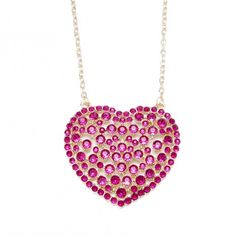 "Product Description     Pink hearts can't lose! This extra-large pave fuchsia heart pendant is made with pink crystal pave rhinestones on a shiny goldtone heart casting. The necklace measures 34"" and has a 3"" extender. The heart-shaped frontal piece measures a bold 3"" x 2.5"". Closes with a lobster claw clasp. $22.99"