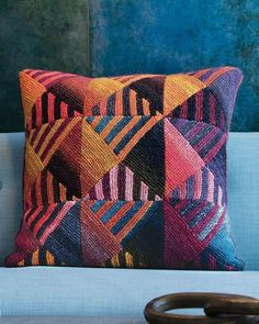 """""""Directional Pillow Cover"""" by Irina Poludnenko from Noro Knitting Magazineissue 9. Knit using two colors of Silk Garden Lite. Mitered triangles combine to form the squares. Add it to your Ravelry queue http://www.ravelry.com/patterns/library/7-directional-pillow-cover See the many colors and patterns of NORO Silk Garden Lite at: https://knittingfever.com/noro/yarn/K-SGL To know NORO is to love NORO!"""