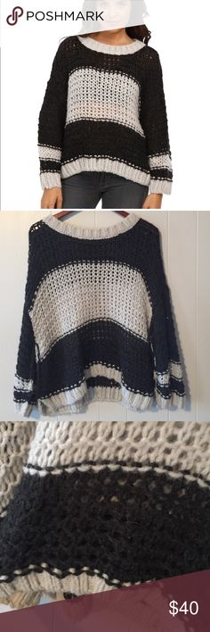 Free People Wool/Alpaca Blend Oversized Sweater Black and white stripe. Slouchy fit with bell sleeves. Open stitch but still cozy. The size tag is missing from this sweater, but it could be small, medium. I wear a Free People size small and enjoyed wearing this as a slouchy fit. In good condition. Free People Sweaters Crew & Scoop Necks