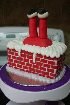 fondant santa legs and bricks on buttercream iced cake