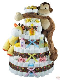 Diaper cake for baby shower. I love how it's decorated with extras!