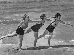 Three women having fun at the beach circa 1950's.