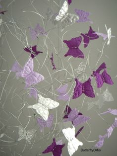 Close up ButterflyOrb, a hanging mobile in purples silver and lavendar for baby room decor