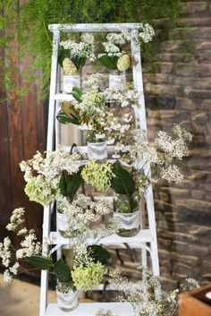 wedding decorations, ladder, baby's breath and hydrangea