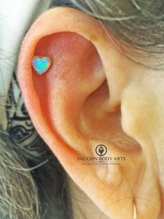 Leslie is officially the first person in Monterey County wearing one of these gorgeous opal hearts from @anatometal. She picked out this lovely light blue opal set in 18k yellow gold in her two month old helix Cody had done. Thanks so much, Leslie! @vaughnbodyarts Monterey, CA