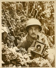 Combat Photographer Norris G. McElroy / Marine PFC Norris G. McElroy, 35, whose wife Margeret McElroy resides at 101 South Bouldin St., Baltimore, MD, is serving with the 1st Marine Division as a Marine Combat Photographer. The Marine invasion of Peleliu Island, in the Palau group, on Sept 15th was McElroy's first operation in WWII. However, he served witht he Marine Corps from 1930 through 1933 in Nicaragua.