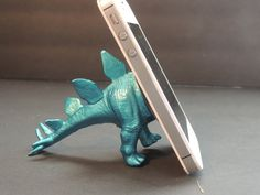 Best thing ever: An upcycled dinosaur toy becomes a clever phone stand. (Or hal - Android Phone Holder - Ideas of Android Phone Holder - Best thing ever: An upcycled dinosaur toy becomes a clever phone stand. (Or half of the toy) Diy Phone Stand, Desk Phone Holder, Iphone Holder, Ipad Stand, Iphone S6 Plus, Dinosaur Toys, Dinosaurs, Ideias Diy, Diy Furniture