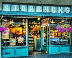 storefront inspiration -- original Starbucks in Pike's Place Market, Seattle.  A little aside... our first Christmas card as a married couple was us standing in the street with this Starbucks in the background.