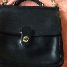 Black leather coach preowned purse Great condition except for a little tarnish on buckle. Coach Bags