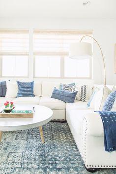 MATTO OLKKARIIN The indigo pillows are from The Woven Home. indigo-pillows-living-room-with-indigo-pillows-on-a-white-sofa-and-an-indigo-rug-indigo-indigopillows-indigorug Coastal Living Rooms, Living Room White, Living Room Sofa, Home Living Room, Living Room Furniture, Living Room Decor, Furniture Ads, Coastal Cottage, Living Spaces
