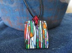 Multicolored rectangular Polymer Clay pendant on by EmbroiderU, $12.00