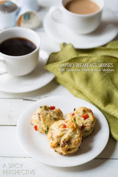 Today I'm sharing a savory scone recipe that is loaded with breakfast favorites. Sausage, muenster cheese, sweet red pepper, garlic and scallions make these tender little biscuits explode with flavor.