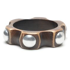 Robyn Bangle  Wheel shaped wood bangle with large silver rivets.