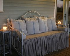 Dreamy Daybed - with feedsack pillows (note the cute & easy tie-tie closures) & that ruffled cover could easily be made from canvas drop cloth(s) - via Craft-O-Maniac