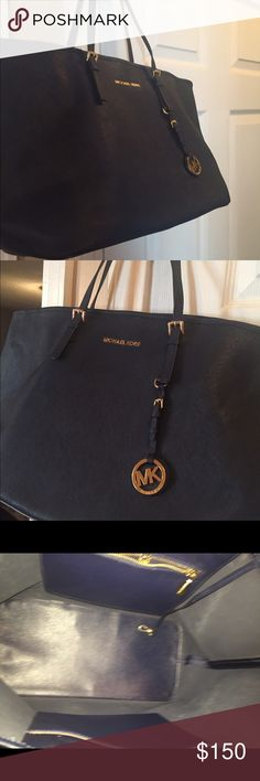 Michael Kors medium tote In good condition no rips or tears comes with dust bag Michael Kors Bags Totes