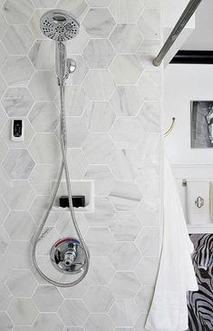 "Hex tiles ""Bathroom makeover via Bliss at Home: Black and white bathroom remodel with Carrara marble hexagon tile, white vintage tub, Delta faucet chrome shower head, and Homewerks Bluetooth bath fan with speakers. Small Bathroom Tiles, Bathroom Design Small, Bathroom Renos, Bathroom Interior Design, Master Bathroom, Bathroom Ideas, Hexagon Tile Bathroom, Shower Tiles, Bathroom Black"