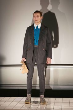 Brianna Finley (2/23): Post 1 - This Acne Studios suit from the Fall 2017 Menswear Fashion Show is very reminiscent of 1930's styles. Similarly to the Scholte suit, it is double breasted and features pinstripes. The slim silhouette and longer jacket gives the Acne Studios suit a more current feel. Brianna Finley 2/23.