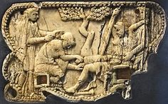 Scene of childbirth in relief on an ivory plaque attached to one end of a papyrus winder (a roller for holding the papyrus while reading). The pregnant woman sits on a birthing chair. Behind her, a standing woman holds her steady as she lifts her left arm backwards to grasp the attendant. The midwife kneels in front of the mother with a sponge in her right hand. Behind her stands a veiled woman who extends her hands toward the mother. Roman. From Pompeii, Region I, Insula 2, first century…