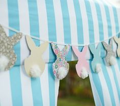 Bunny Garland | Pottery Barn Kids:  GET CUTE CARDSTOCK AT PAPERSOURCE  OR JOANNE'S - GLUE ON POM-POMS - TACK OR GLUE ONTO RIBBON - FUN EASY EASTER PROJECT FOR LITTLE ONES!!!