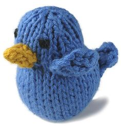 """A tiny little bluebird is knit in Comfort.  Size Approximately 3"""" across x 3"""" high  Materials 1 Ball Berroco Comfort (100 grs), #9735 Delft Blue, and a small amount each #9743 Goldenrod (gold) and #9734 Liquorice (black) 1 Set (4) double pointed knitting needles (dpn), size 7 (4.50 mm) OR SIZE TO OBTAIN GAUGE Tapestry needle Polyester stuffing 1 St marker  Gauge 22 sts = 4""""; 29 rows = 4"""" in St st"""