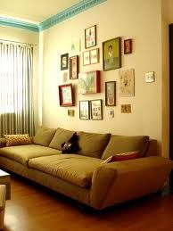 I love the big couch and the collage of pictures on the wall