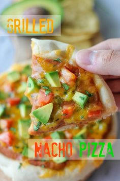 Grilled Nacho Pizza - An easy grilled pizza loaded with refried beans, tomatoes, green chiles, fresh avocado and melted sharp cheddar!